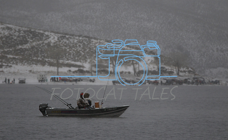 Hundreds of fishermen brave an early morning snow storm at Topaz Lake, at the Nevada-California state line, on Saturday,  January 1, 2011, for the opening day of fishing season. .Photo by Cathleen Allison