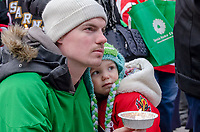 Former Humboldt Broncos hockey player Brad Biggers and his daughter, two-year-old Deklan, of Point Edward, listen to speakers. About eight years ago, Brad played 15 games for the team before being traded. <br /> <br /> An estimated crowd of around 200 (Point Edward OPP) turned out for a candle light vigil to remember 15 players and management of the Humboldt Broncos hockey team killed in a bus crash in Saskatchewan.