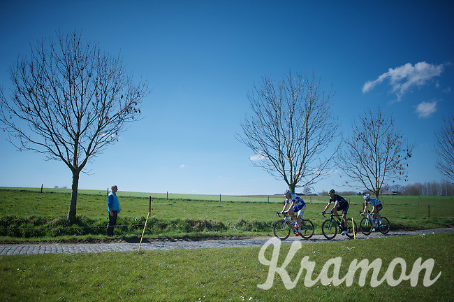 what is left of the first escape group riding over the Haaghoek cobbles<br /> <br /> 100th Ronde van Vlaanderen 2016