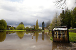 Pix: Shaun Flannery/shaunflanneryphotography.com...COPYRIGHT PICTURE>>SHAUN FLANNERY>01302-570814>>07778315553>>..26th April 2012..Flooded canal and River Don at Sprotbrough, Doncaster..Recycling station.