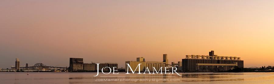 Grain elevators in Duluth Harbor at sunset.