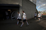 Edinburgh City v Spartans, 11/04/2015. Commonwealth Stadium, Scottish Lowland League. Home team players walking back to the dressing rooms at the Commonwealth Stadium at Meadowbank at the conclusion of the Scottish Lowland League match between Edinburgh City (white shirts) and city rivals Spartans, which was won by the hosts by 2-0. Edinburgh City were the 2014-15 league champions and progressed to a play-off to decide whether there would be a club promoted to the Scottish League for the first time in its history. The Commonwealth Stadium hosted Scottish League matches between 1974-95 when Meadowbank Thistle played there. Photo by Colin McPherson.