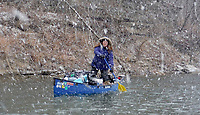 NWA Democrat-Gazette/DAVID GOTTSCHALK Amanda Kay Whelchel-Harris stands Sunday, February 5, 2018, to find a floatable channel on the Meramec River as a snow storm begins while floating. Eight paddlers from the Fayetteville area spent February 2-10, 2018 floating 46 miles of the spring fed river in Missouri.