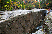 """A section of rocky gorge just above the """"other"""" Pitcher Falls, located on the South Fork of the Hancock Branch in the White Mountains, New Hampshire USA during the autumn months."""
