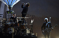 Musicians (l-r), Larry Mullen junior, Paul David Hewson (Bono) and Adam Clayton of the Irish band U2 on stage at the Olympic Stadium in Berlin, Germany, 12 July 2017. Photo: Britta Pedersen/dpa-Zentralbild/dpa /MediaPunch ***FOR USA ONLY***