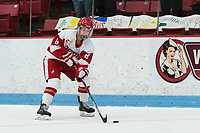 BOSTON, MA - JANUARY 11: Deziray De Sousa #8 of Boston University brings the puck forward during a game between Providence College and Boston University at Walter Brown Arena on January 11, 2020 in Boston, Massachusetts.