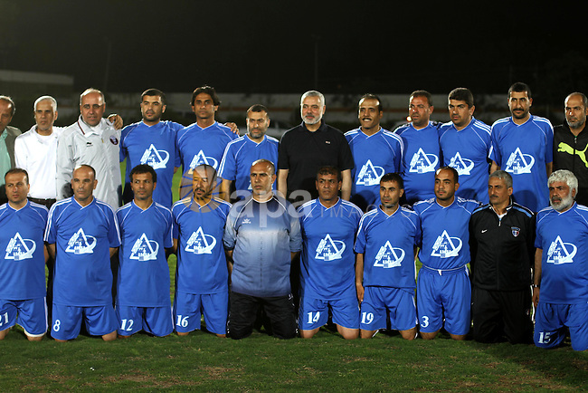 Palestinian Prime Minister in Gaza Strip Ismail Haniyeh participate in a football match at al-Yarmouk stadium, marking the Traffic Day, in Gaza City on May 5, 2014. Photo by Mohammed Asad