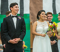 NWA Democrat-Gazette/ANTHONY REYES &bull; @NWATONYR<br /> Rogers Heritage Homecoming king and queen, Alex Gutierrez and Alyin Pulido greet the student body Friday, Sept. 25, 2015 after their coronation during the school's homecoming rally in Rogers. The event including the introduction of the 2015 homecoming court, musical performances, dancing and a pep rally for a football game against Springdale.