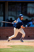 Mobile BayBears shortstop Angel Rosa (14) follows through on a swing during a game against the Pensacola Blue Wahoos on April 26, 2017 at Hank Aaron Stadium in Mobile, Alabama.  Pensacola defeated Mobile 5-3.  (Mike Janes/Four Seam Images)