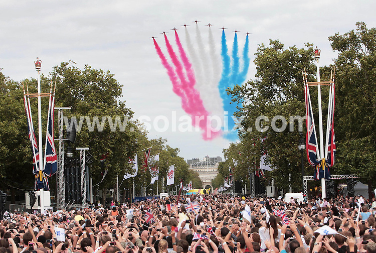 **ALL ROUND PICTURES FROM SOLARPIX.COM**.**NO UK NEWSPAPER PUBLICATION **UK MAGAZINE & SUPPLEMENT PUBLICATION ONLY** AND NO PUBLICATION IN FRANCE, SCANDINAVIA, AUSTRALIA AND GERMANY** .The official hand over for  the 2012 Olympic games took place by Buckingham Palace in central London..This pic:red arrows display team..JOB REF:7113-SFE       DATE:24_08_08 .**MUST CREDIT SOLARPIX.COM OR DOUBLE FEE WILL BE CHARGED* *UNDER NO CIRCUMSTANCES IS THIS IMAGE TO BE REPRODUCED FOR ANY ONLINE EDITION WITHOUT PRIOR PERMISSION*