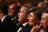 12 June 2005 - Washington, DC - President George W. Bush and First Lady Laura Bush attend the celebration in honor of US troops overseas.  The celebration was held at the historic Ford's Theatre. Siting to the left President and first lady was Vice President Dick Cheney and Lynne Cheney.  To the right of them was Nicholas E. Charaja.  After the program the President and First Lady went on stage to deliver remarks.  Standing with them were the performers including: Hilary Duff, Jeff Foxworthy, Josh Gracin, Geena Davis, Denyce Graves, Julie Roberts, and Jesse McCarthy.<br /> Credit: Gary Fabiano - Pool via CNP