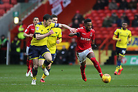 Tariqe Fosu of Charlton Athletic tries to shake off a challenge from Oxford United's John Mousinho during Charlton Athletic vs Oxford United, Sky Bet EFL League 1 Football at The Valley on 3rd February 2018