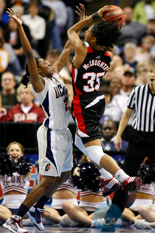 07 APR 2009:  Kalana Greene (32) of the University of Connecticut defends Angel McCoughtry (35) of the University of Louisville during the Division I Women's Basketball Championship held at the Scottrade Center in St. Louis, MO.  Connecticut defeated Louisville 76-54 for the national title.  Jamie Schwaberow/NCAA Photos