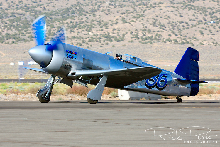 Sherman Smoot taxies the Unlimited Air Racer Czech Mate after finishing a heat race during the 2008 Reno National Championship Air Races held annually at Stead Field, Nevada. Czech Mate, a modified Yak 11 powered by a Pratt & Whitney R2800 Radial Engine, finished 4th in the Gold Unlimited Finals with a speed of 424.517 mph.