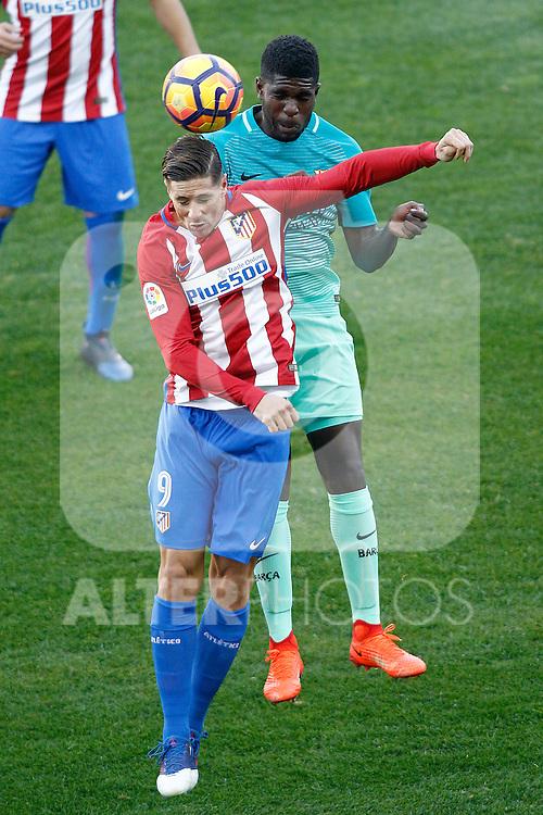 Atletico de Madrid's Fernando Torres (l) and FC Barcelona's Samuel Umtiti during La Liga match. February 26,2017. (ALTERPHOTOS/Acero)