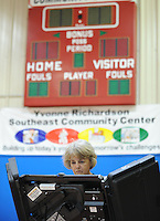 NWA Democrat-Gazette/ANDY SHUPE<br /> Betty Garretson pauses as she votes Tuesday, Sept. 15, 2015, in the school board election at the Yvonne Richardson Community Center in Fayetteville.