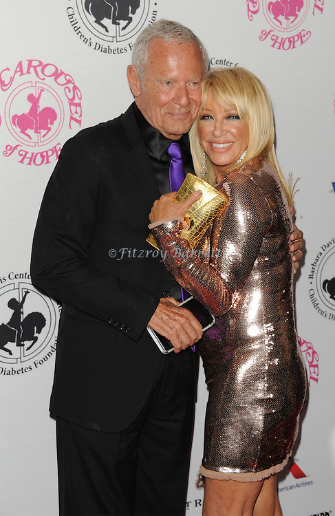 Suzanne Somers and Alan Hammel arriving at The 2016 Carousel Of Hope Ball held at the Beverly Hilton Hotel Beverly Hills California October 8, 2016.