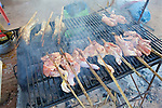 Barbecuing Food In Local Market
