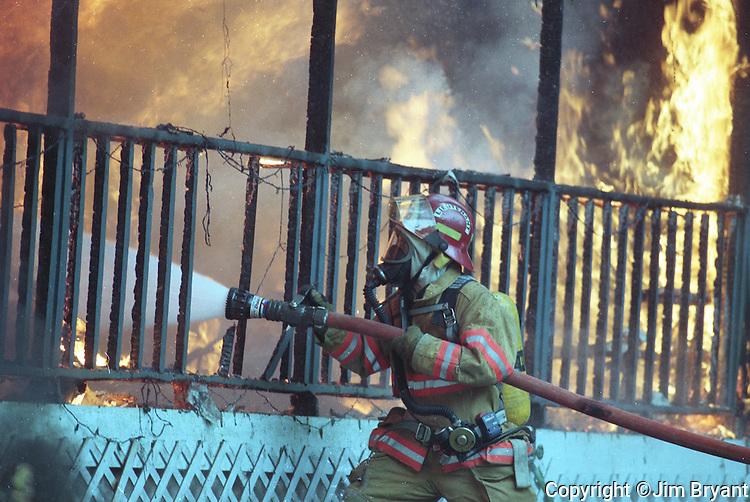 A South Kitsap Fireman fights a house fire. Jim Bryant Photo