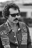 DAYTONA BEACH, FL - FEBRUARY 14: Richard Petty, driver of the Petty Enterprises Pontiac, walks through the garage area before practice for the NASCAR Winston Cup race at the Daytona International Speedway in Daytona Beach, Florida, on February 14, 1982.