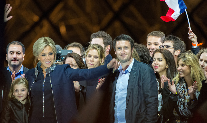 Celebration of Emmanuel Macron's victory in the French Presidential election at the Louvre, Sunday 7th May 2017. Towards the left, Brigitte Macron / Trogneux, Mr Macron's wife, beside her, Emma, Brigitte's grand-daughter, to the right of Brigitte, Tiphane Auzière, Brigitte's daughter, and beside her, Antoine Choteau, her partner. The first round of the Presidential election took place on Sunday 23rd April 2017 with 11 candidates, not including the incumbent President, François Hollande, who opted not to stand on account of low popularity ratings. The favorite at the outset was the (Conservative) candidate for Les Républicains, François Fillon, but his popularity declined dramatically when the french newspaper Le Canard Enchainé revealed that he had been paying his (English) wife approximately €100,000 a year, for several years, from public funds, the so called 'Penelopegate' affair. Jean-Luc Mélenchon (La France Insoumise) performed remarkably well in the first round, ending fourth, with 19.58%, just behind Fillon, but Benoit Hamon, though selected in by the Parti Socialistin their primary, failed to impress, and the two winners of the first round were Emmanuel Macron with his new party En Marche(24.01%) and Marine le Penn for the Front National (21.3%). The second round voting took place on Sunday 7th May 2017 and the result was announced at 8.00 pm: Emmanuel Macron 66.1%; Marine le Penn 33.9%. Macron therefore becomes President at the age of 39, the youngest President of the Fifth Republic and the youngest ruler of France since Napoleon. The choice of the Louvre for the post election celebration was a novel choice, supposedly representing the historic past, heritage, and continuity, whilst also being the seat of power from the time of Henry IV up to Napoleon, with monarchic overtones. The ceremony took place in front of the Pyramid designed by Leoh Ming Pei, commissioned by François Mitterand in 1983. This was deemed to add a spiritual aspect to the event