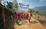 "Women march together in celebration of International Women's Day on March 8, 2016, in Dhawa, a village in the Gorkha District of Nepal.<br /> <br /> The banner reads, ""106th International Women's Day"" and ""Implement the Constitution and Guarantee Women's Rights."""