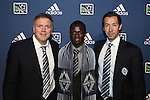January 17th, 2013: #4 draft pick Kekuta Manneh (GAM), selected by the Vancouver Whitecaps FC, with team President Bob Lenarduzzi (left) and head coach Martin Rennie (SCO) (right). The 2013 MLS SuperDraft was held during the NSCAA Annual Convention held in Indianapolis, Indiana.
