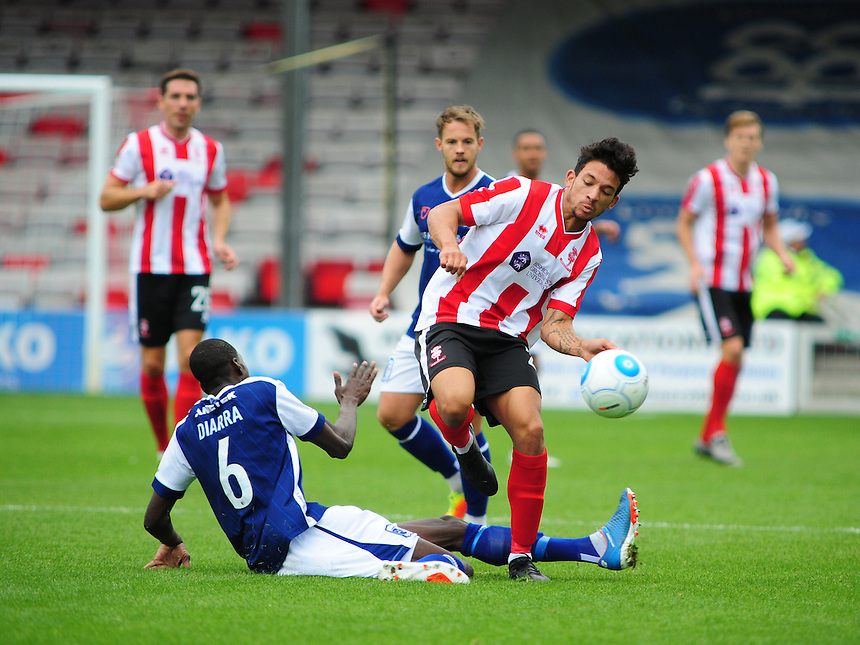 Barrow's Moussa Diarra vies for possession with Lincoln City's Macauley Bonne<br /> <br /> Photographer Andrew Vaughan/CameraSport<br /> <br /> Vanarama National League - Lincoln City v Barrow - Saturday 17 September 2016 - Sincil Bank - Lincoln<br /> <br /> World Copyright &copy; 2016 CameraSport. All rights reserved. 43 Linden Ave. Countesthorpe. Leicester. England. LE8 5PG - Tel: +44 (0) 116 277 4147 - admin@camerasport.com - www.camerasport.com