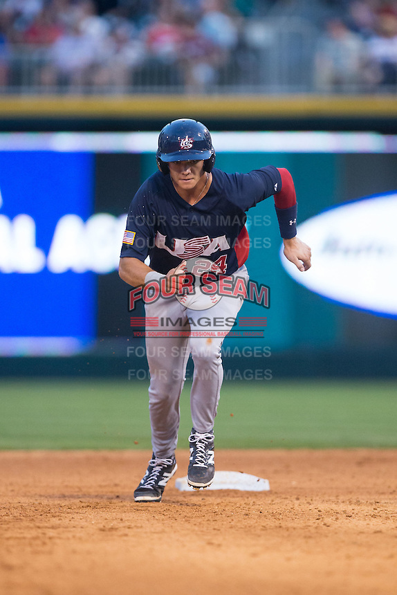 Bobby Dalbec (24) of the US Collegiate National Team hustles towards third base against the Cuban National Team at BB&T BallPark on July 4, 2015 in Charlotte, North Carolina.  The United State Collegiate National Team defeated the Cuban National Team 11-1.  (Brian Westerholt/Four Seam Images)