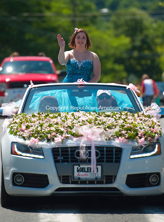 WINSTED, CT--061315JS04- Laurel Queen candidate Molly Robitaille  rides in a car during during the 2015 Laurel Festival Parade and ceremonies in Winsted on Saturday. Robitaille, who was sponsored by the Daughters of the American Revolution, was the first runner-up. <br /> Jim Shannon Republican-American
