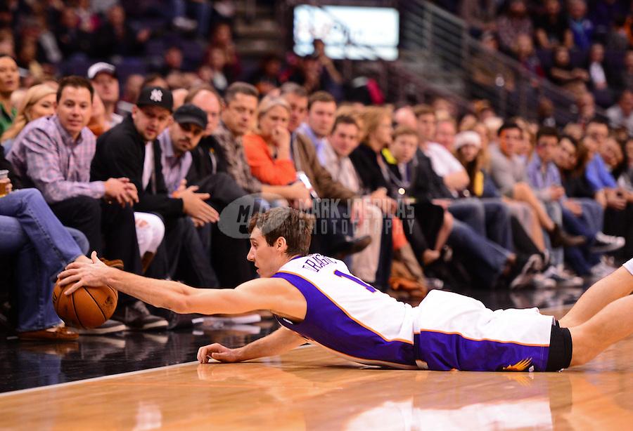 Jan. 2, 2013; Phoenix, AZ, USA: Phoenix Suns guard Goran Dragic dives for a loose ball in the first half against the Philadelphia 76ers at the US Airways Center. Mandatory Credit: Mark J. Rebilas-USA TODAY Sports
