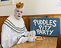 """Edinburgh, UK. 17.08.2016. Puddles Pity Party, the clown with the golden voice, sits, alone, in Circus Cafe, for """"a coffee, a pie, and a cry"""". Puddle's new show, """"Let's Go"""", is on at Assembly George Square, as part of the Edinburgh Festival Fringe. Photograph © Jane Hobson."""