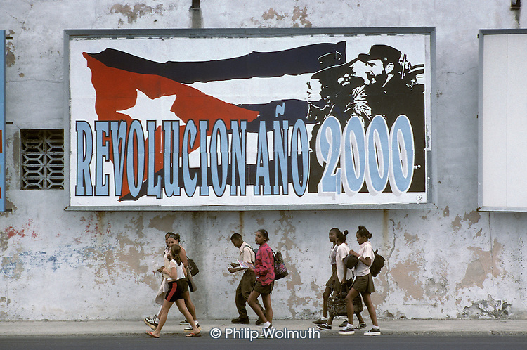 School children pass a street hoarding in Central Havana celebrating the anniversary of the 1959 revolution.