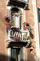 Flowers on balcony in Venice Italy.