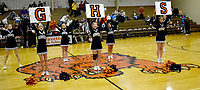 """Westside Eagle Observer/MIKE ECKELS<br /> <br /> Keeping the fans energized during half time of the Lions-Tigers boys game in the competition gym Jan. 14, the Gravette Lions cheerleaders leads the crowd in the """"GHS"""" (Gravette High School) cheer. One of the purposes of the cheer team is to keep the fans into the game giving inspiration to the players during the contest."""