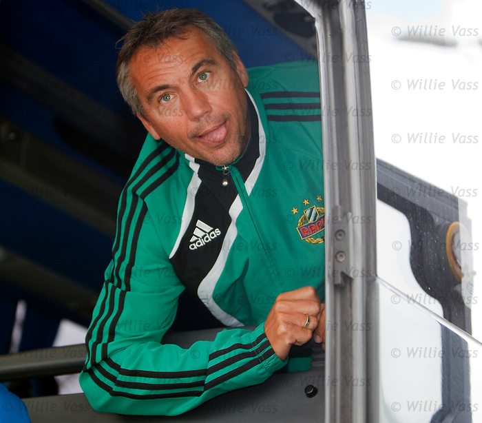 Rapid Vienna boss Peter Pacult clowns around on the team bus