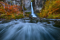 Fall color frames this iconic waterfall near El Chalten.