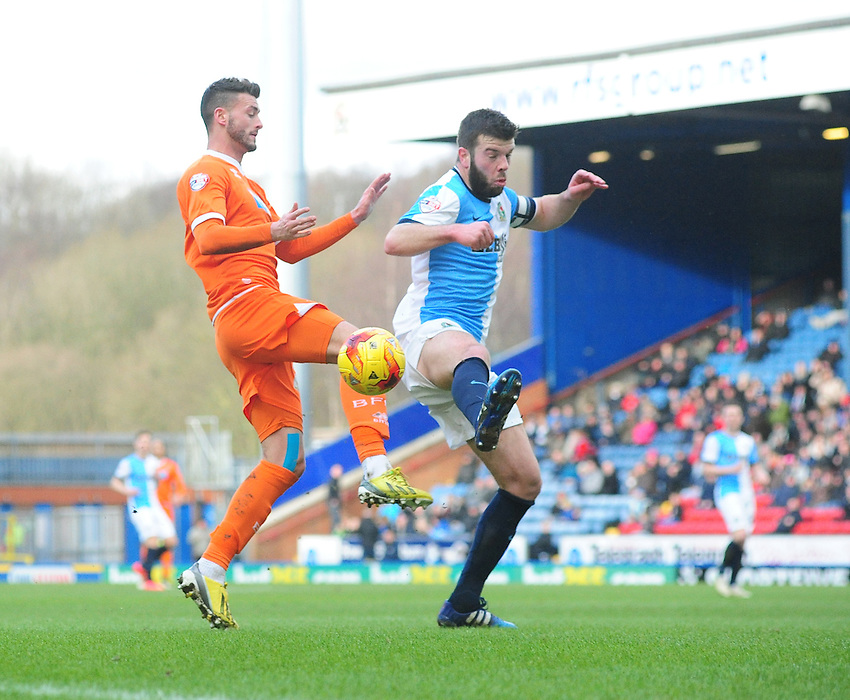 Blackpool's Gary Madine vies for possession with Blackburn Rovers' Grant Hanley<br /> <br /> Photographer Chris Vaughan/CameraSport<br /> <br /> Football - The Football League Sky Bet Championship - Blackburn Rovers v Blackpool - Saturday 21st February 2015 - Ewood Park - Blackburn<br /> <br /> &copy; CameraSport - 43 Linden Ave. Countesthorpe. Leicester. England. LE8 5PG - Tel: +44 (0) 116 277 4147 - admin@camerasport.com - www.camerasport.com