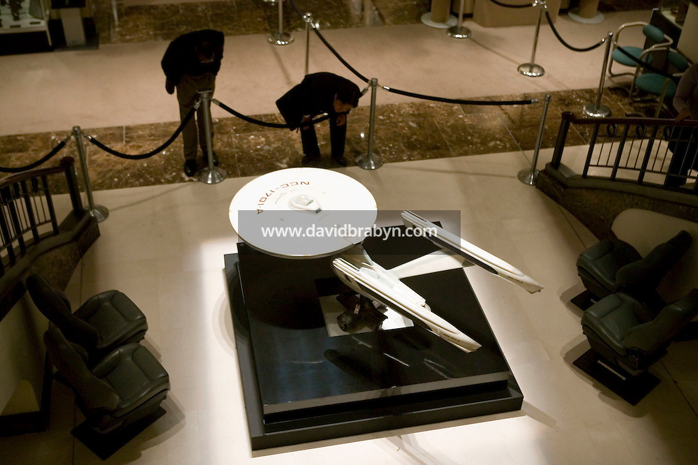 2 October 2006 - New York City, NY - Two men examine a model of spaceship Entreprise-A seen in Star Trek IV, V, and VI on display at the preview of items from the TV show Star Trek at Christie's auction house in New York City, USA, 2 October 2006. The auction, on October 5-7, celebrates the show's 40th anniversary. The model is expected to fetch between $15,000 and $25,000.