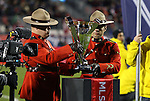21 November 2010: Two members of the Royal Canadian Mounted Police carry the Philip F. Anschutz Trophy onto the field before the game. The Colorado Rapids defeated FC Dallas 2-1 in overtime at BMO Field in Toronto, Ontario, Canada in MLS Cup 2010, Major League Soccer's championship game.