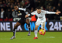 (L-R) Odion Ighalo of Watford challenges Leon Britton of Swansea during the Barclays Premier League match between Swansea City and Watford at the Liberty Stadium, Swansea on January 18 2016