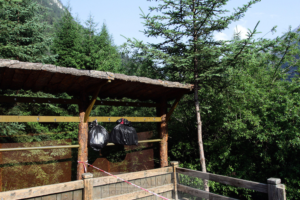 Garbage bags hang in the Jiuzhaigou National Park. Sichuan Province. China.