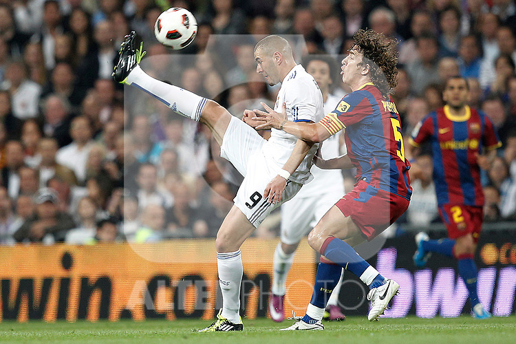 Real Madrid's Karim Benzema and FC Barcelona's Carles Puyol during la Liga match on April 16th 2011...Photo: Cesar Cebolla / ALFAQUI