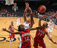 Dec. 6, 2010; Charlottesville, VA, USA; Radford Highlanders guard Breshara Gordon (12) and Radford Highlanders guard Denay Wood (11) reach for a rebound in front of Virginia Cavaliers center Simone Egwu (4) at the John Paul Jones Arena. Virginia won 76-52. Mandatory Credit: Andrew Shurtleff-