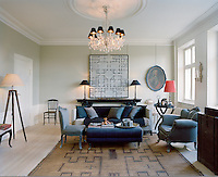 The light-filled living room is furnished with a combination of antique and contemporary pieces