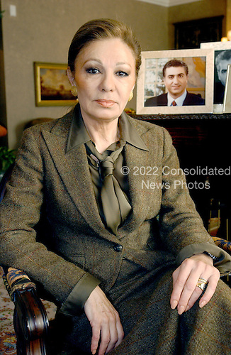 """Empress Farah Diba Pahlavi, the former Queen of Iran, discusses her life with the former Shah of Iran, Mohammed Reza Pahlavi, during an interview in McLean, Virginia on February 20, 2004.  She was the third wife of the Shah.  The Empress discussed her memoirs """"An Enduring Love: My Life with the Shah"""".  A photo of her son, Reza, is seen at right..Credit: Ron Sachs / CNP"""