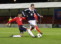 Hakob Loretsyan makes a crucial tackle on John Herron in the Scotland v Armenia UEFA European Under-19 Championship Qualifying Round match at New Douglas Park, Hamilton on 9.10.12.