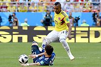 SARANSK - RUSIA, 19-06-2018: Jose IZQUIERDO (Der) jugador de Colombia disputa el balón con Hiroki SAKAI (Izq) jugador de Japón durante partido de la primera fase, Grupo H, por la Copa Mundial de la FIFA Rusia 2018 jugado en el estadio Mordovia Arena en Saransk, Rusia. /  Jose IZQUIERDO (R) player of Colombia fights the ball with Hiroki SAKAI (L) player of Japan during match of the first phase, Group H, for the FIFA World Cup Russia 2018 played at Mordovia Arena stadium in Saransk, Russia. Photo: VizzorImage / Julian Medina / Cont
