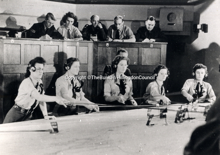 BNPS.co.uk (01202 558833)<br /> Pic: TheBunker/HillingdonCouncil/BNPS.<br /> <br /> The control room in operation during the war.<br /> <br /> The 11 Group control room from where the Few took on the might of Goerings Luftwaffe in 1940.<br /> <br /> The historic room from which the Battle of Britain was won has opened to the public after Hillingdon council acquired the site from the RAF.<br /> <br /> The defence of the capital and much of southern England was conducted from 11 Group control room at RAF Uxbridge during the dark days of 1940 and later the air support for the D-Day landings in June 1944.<br /> <br /> And Churchill even came up with his 'Never in the field of human conflict was so much been owed by so many to so few' on climbing the stairs out of the concrete bunker after witnessing a ferocious days fighting at the height of the Battle in August 1940.<br /> <br /> The new visitor centre is now fully open to the public after a multi million pound redevelopment that recreates exactly the control room at 11.30am on the 15th September 1940...Battle of Britain day.