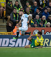 Blackburn Rovers' Adam Armstrong (left)  is tackled by Norwich City's Ben Godfrey (right) <br /> <br /> Photographer David Horton/CameraSport<br /> <br /> The EFL Sky Bet Championship - Norwich City v Blackburn Rovers - Saturday 27th April 2019 - Carrow Road - Norwich<br /> <br /> World Copyright © 2019 CameraSport. All rights reserved. 43 Linden Ave. Countesthorpe. Leicester. England. LE8 5PG - Tel: +44 (0) 116 277 4147 - admin@camerasport.com - www.camerasport.com